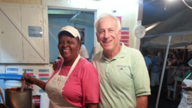 The author is all smiles with Gemma, the owner and head chef at his favorite Antigua restaurant.