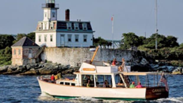 The restored wooden vessel Gansett cruises off Rose Island, R.I.