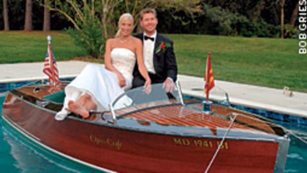 An old wooden runabout neatly tied up in a swimming pool is not something you see every day, but it is when a young Maryland couple decided to create a memorable wedding day photo.