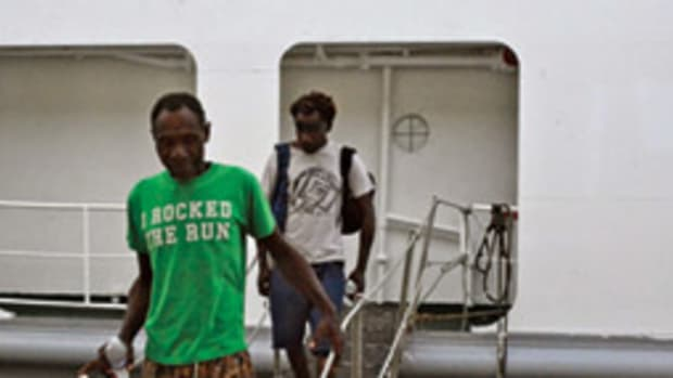 Michael Bolong (left) and Ambros Wavut spent more than four months adrift in a small boat.