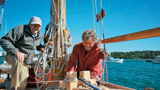 Richard Stanley, right, is stepping to the forefront as his father, Ralph, retires from boatbuilding. The older Stanley will spend his retirement crafting violins.