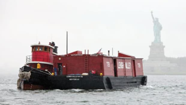 Capt. Pamela Hepburn has done all she can to keep the tug Pegasus (here with the Waterfront Museum barge) on the water.