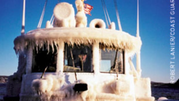 The icing aboard this Coast Guard harbor tug's pilothouse shows how the vessel could become top-heavy.