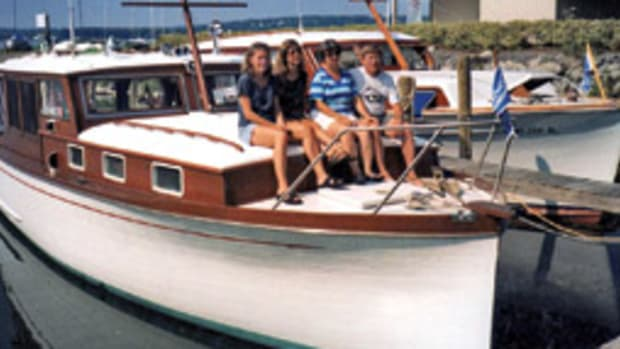 Don and the family aboard White Cap in its pre-solar panel days.