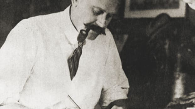 L. Francis at his drafting board at Burgess, Swasey and Paine in 1925.