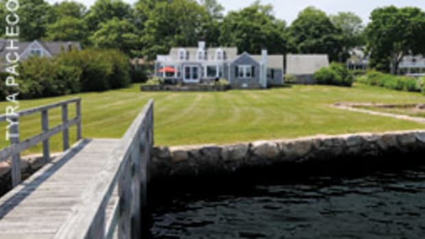 This home in Marion, Mass, has a bulkheaded waterfront and a private dock.