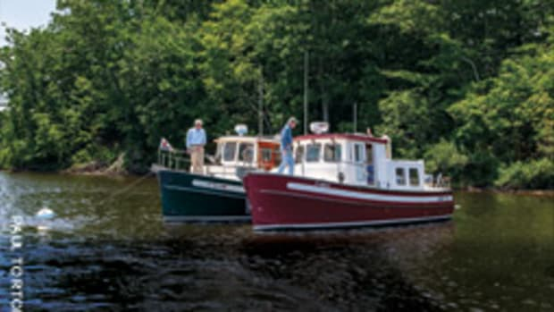 Connecticut boaters Geoffrey Balshaw (left) and Bill Bucknall each switched from sailboats to a Nordic Tug 26.