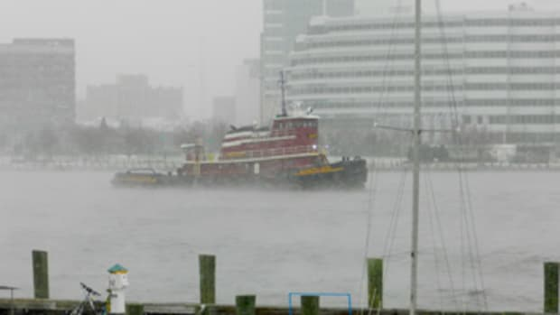 Tugs such as the Eileen McAllister must report for work in just about any weather.