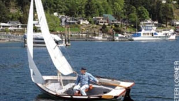 Dave Robertson reaching across the bay of Gig Harbor in his 17-foot Jersey Skiff.