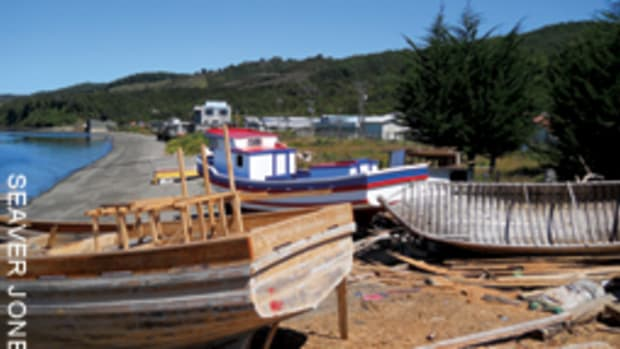 Boatbuilders set up shop on the beach on Chiloe, an island off Chile.