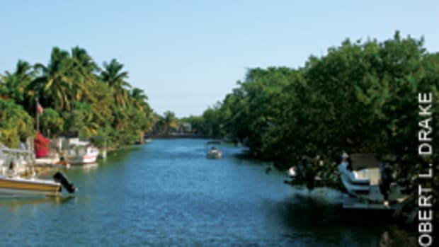 The view from the three-bedroom house in the Florida Keys is down a quiet canal.