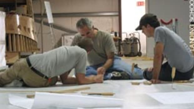 As part of the Wood Composite course, instructor Rick Barkhuff works with students to loft the Arundel 27.