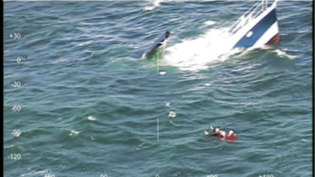 The 32-foot boat was taking on water when the two aboard contacted the Coast Guard.