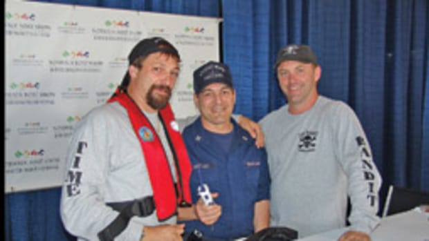 Capt. John Hillstrand, Cmdr. Art Gottleib and Capt. Andy Hillstrand discuss the value of wearing life jackets and carrying VHF radios at the Norwalk (Conn.) International Boat Show.