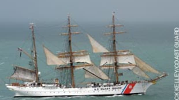 The crew aboard Coast Guard cutter Eagle, far from its New London, Conn., home port work to take in the sails July 2 as the ship heads to Corpus Christi, Texas. Crewmen work in the rigging nearly 100 feet above the water.