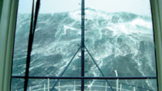 A huge sea as seen from a pilothouse.