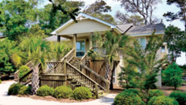 This home on Bogue Sound sits amid shade trees, yet is less than a mile from the ocean sands in Atlantic Beach, N.C.