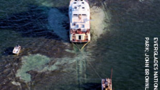 An aerial view of a boat being prepared for towing after grounding in Everglades National Park. It can take seagrass beds several years to recover from prop damage like this.