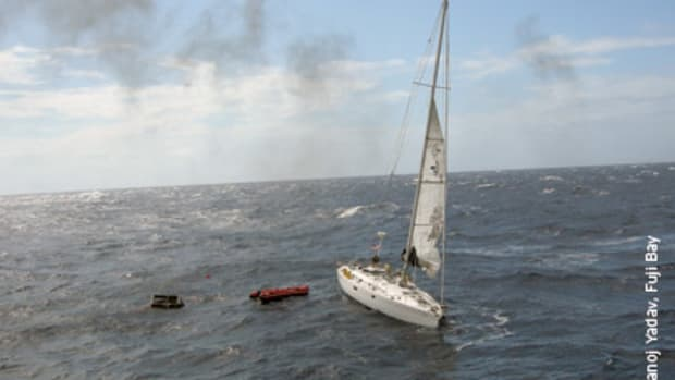 Blue Chip as she was last seen, about 105 nautical miles south of Kingston, Jamaica. The unusable life raft is pictured at left.