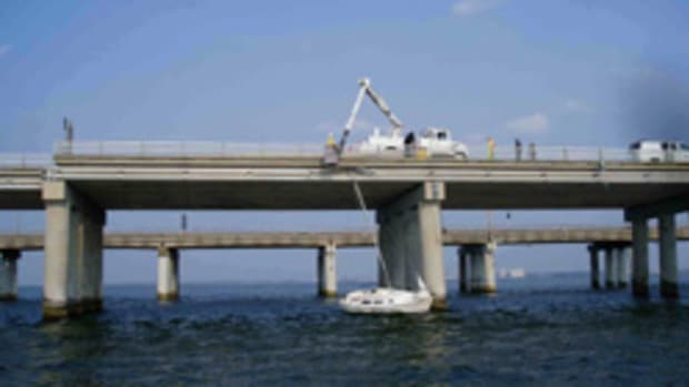 Sea Tow Hampton Roads (Va.) frees a sailboat Sunday from the Chesapeake Bay Bridge-Tunnel.