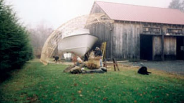Dan Stubbings, 46, bought a Duffy 38 kit boat from Atlantic Boat Co. in Brooklin, Maine, and built a temporary canopy on his barn to fiinish it off.