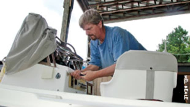 Todd Grenier of Whelan's Marine works on the new Yamaha installation aboard Tom's 20-foot Mako.