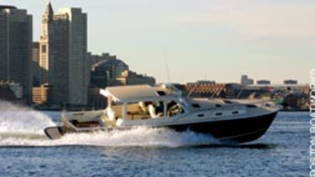 The first MJM 40 powers around in Boston Harbor outside the BBW shop.