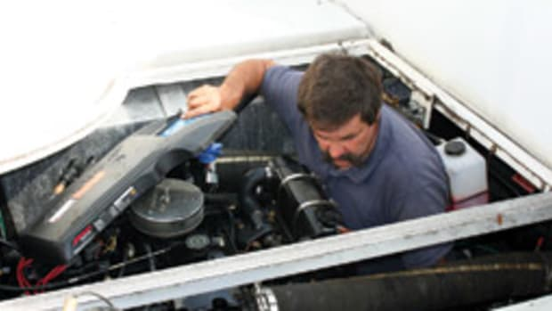 Klockars inspects an engine on a Carver 350 Mariner for such things as worn belts, cracked hoses and corroded connections.