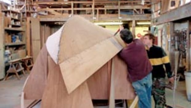 Builders stitch the hull of a 33-foot Devlin lobster yacht.