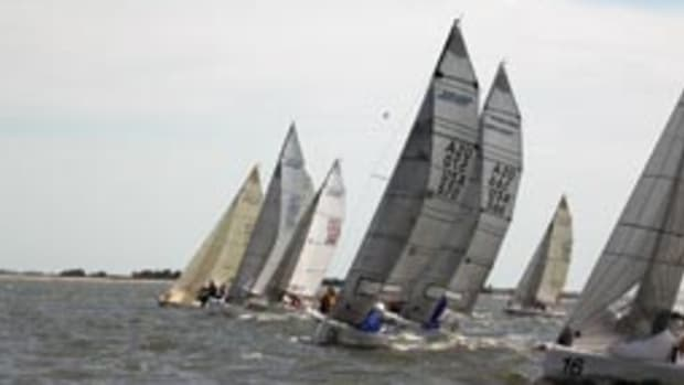 The racing was near ideal for this year's Charleston Race Week. Among the young sailors taking to the sport is Riley Chadwick, 12, aboard the No. 6 boat, Cujo (center).