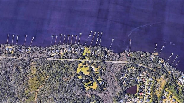 One Mile Swath of River: This satellite images provides a typical view of a little more than a mile of the river's south bank. Most of these 37 residental docks are likely damaged or destroyed.