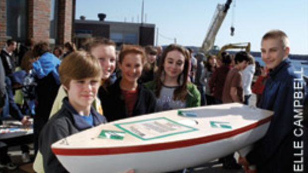Students from Wagner Middle School in Winterport, Maine, with their mini-boat, Pridetanic, which landed in Portugal after seven months on the Atlantic
