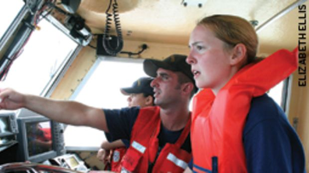 Sea Scout Rachel Sampson gets some navigation tips from Coast Guardsman Matthew Vail during a safety session held at the biennial Koch Cup Regatta.