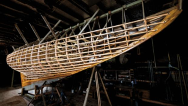 The Fife 8 Meter Invader II takes form at Wooden Boatworks on eastern Long Island. Steve Lubitz fits the beam shelf that will soon support the deck.