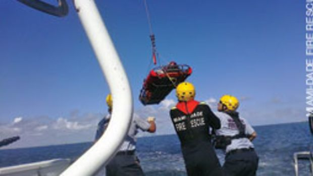 One of the victims is hoisted on board for medical treatment.