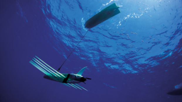"The Wave Glider comprises a floater with a solar panel tethered to a ""wave engine"" below that moves the vessel forward."