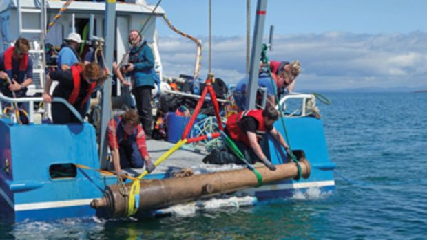 Archaeologists recover a bronze cannon from La Juliana, a merchant ship that was part of the Spanish Armada when it sank in 1588.