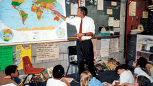 Wilson visits a classroom at Pierce School in Brookline, Mass., as part of the educational progrma.