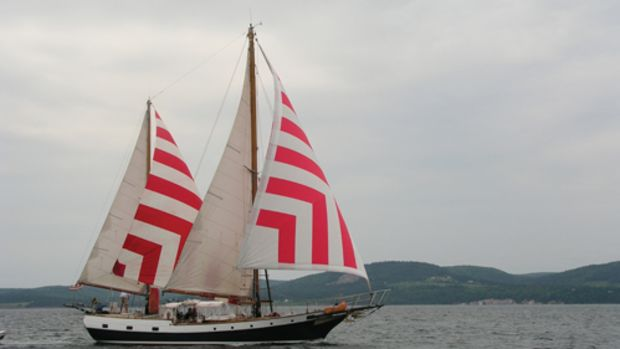 Irving Johnson's famous ketch Yankee flies every stitch of canvas reaching across Bras d'Or Lake in Nova Scotia. Photo by Gordon van Nes.