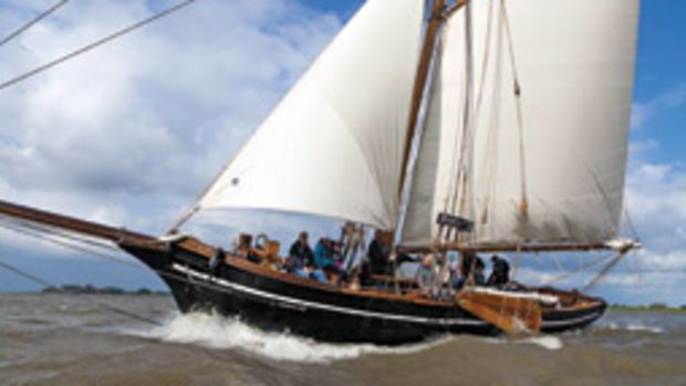 The 1853 revenue cutter Rigmor enjoys a blustery day on the Elbe River.