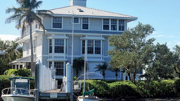 The house has an 80-foot dock and a large first-floor porch.