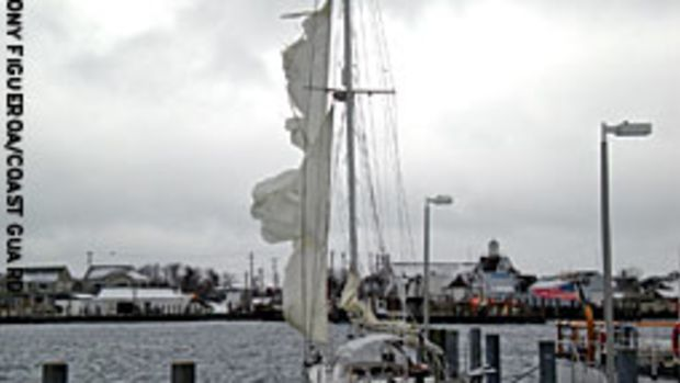 The sailing vessel Moonshine is pictured at the dock at Coast Guard Station Montauk, N.Y., after the Coast Guard rescued a four-person crew caught in an offshore storm that shredded the sails.