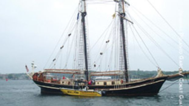 A Sea Tow boat works to free the 118-foot tall ship Unicorn Aug. 5 after it ran aground on rocks in Great Harbor near Woods Hole, Mass.