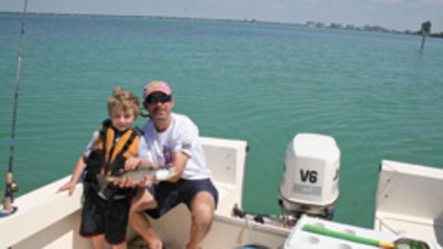 The author's son Jake and husband, Darrell, fishing near Sarasota, Florida, on their Parker.