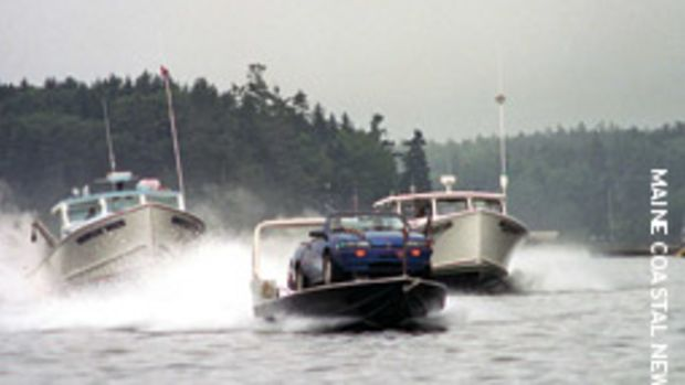 Maine boatyard owner Steve Johnson succeeded in his attempt to draw attention to the annual Maine lobster boat races with his Ca'-Boat.