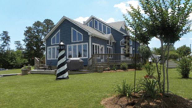 The home on Jackson Creek is just five minutes from Chesapeake Bay. With ample windows, it's de-signed to provide water views and let natural light pour in. Water depth at the dock is 5 feet at mean low water.