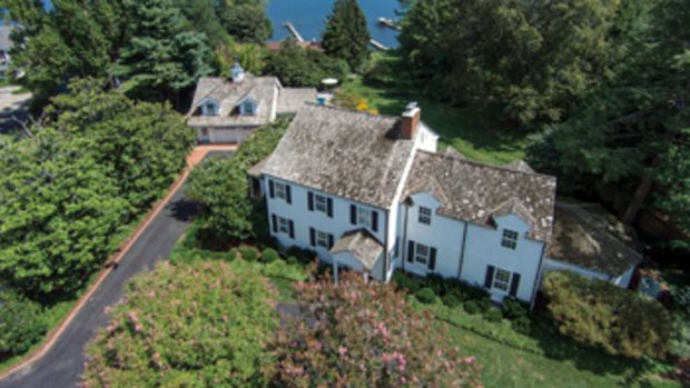 The Trumpy Estate was built in 1948 and includes a deepwater dock; a covered poolside open-air dining area; and a granite-topped island that divides the kitchen from the breakfast area.