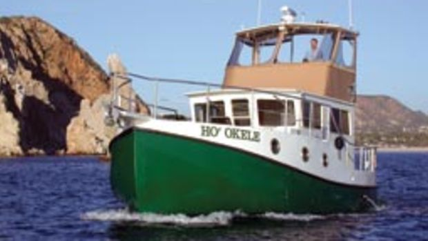 The writer pilots Ho'Okele from the flybridge along Mexico's Pacific Coast.
