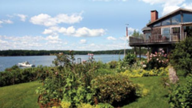 The two-story house overlooks Davis Cove and the mouth of the Meduncook River.