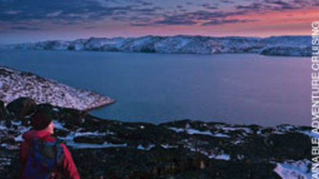 Phyllis Nickel admires the noon light from a hill in Greenland.